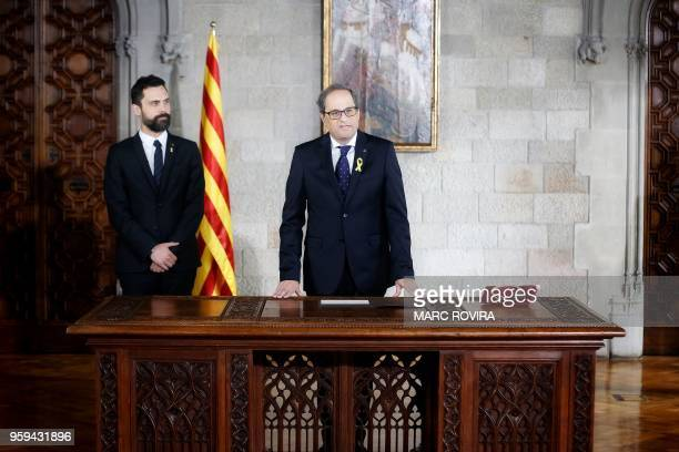 Newly appointed Catalan president Quim Torra delivers a speech next to Catalan parliament speaker Roger Torrent as he takes office during an official...