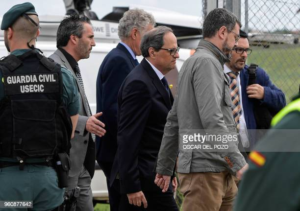 Newly appointed Catalan president Quim Torra leaves after a visit to jailed Catalan separatist politicians at the Estremera jail near Madrid on May...