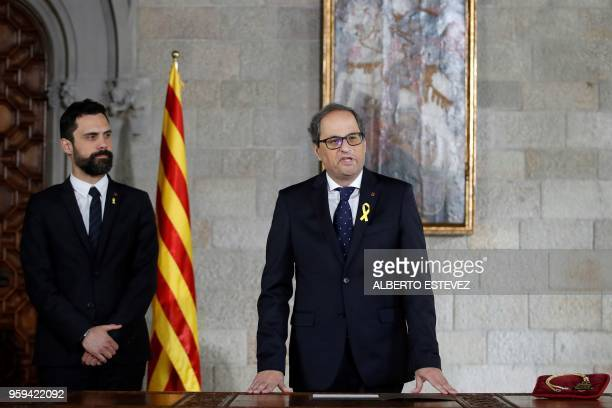 Newly appointed Catalan president Quim Torra takes office next to Catalan parliament speaker Roger Torrent during an official ceremony at the...