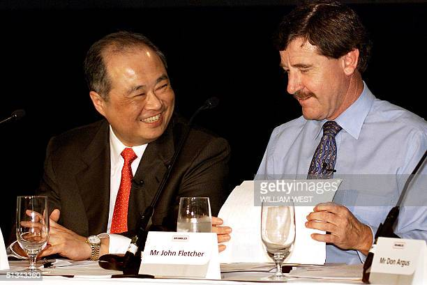 Newly appointed Chief Executive Hong Kong born Sir C K Chow shares a joke at a press conference announcing the merger of the Brambles GKN groups with...