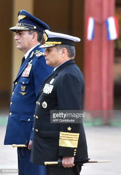 Newly appointed Commander in Chief of the Paraguayan Military Forces Admiral Hugo Milciades Scolari Pagliaro listens to the national athem next to...