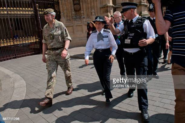 Newly appointed Commissioner of the Metropolitan Police Service Cressida Dick walks with Mark Turner of the Parliamentary and Diplomatic Protection...