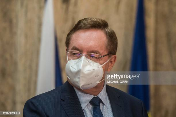 Newly appointed Czech Health Minister Petr Arenberger looks on as he speaks to the media during his inauguration to the new office on April 7, 2020...
