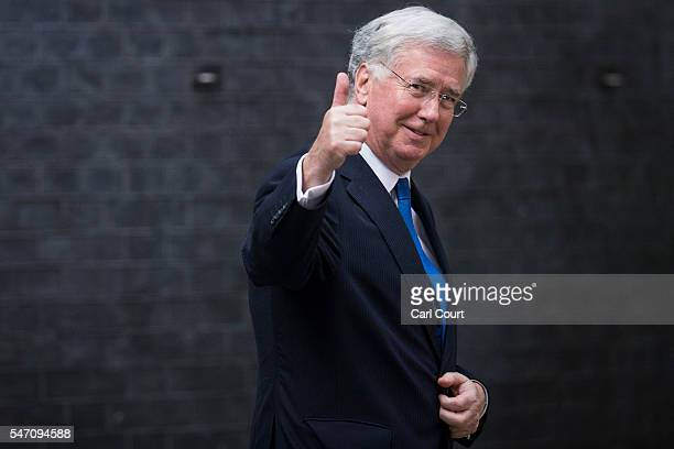 Newly appointed Defence Secretary Michael Fallon gives a thumbs up as he leaves Downing Street on July 13 2016 in London England The UK's New Prime...