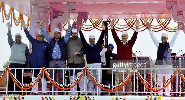 Newly appointed Delhi CM Arvind Kejriwal with his ministers after the swearing in ceremony at the Ramlila Ground on February 14 2015 in New Delhi...