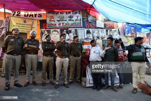 Newly appointed Deputy Commissioner of Police Rajendra Prasad Meena addresses the gathering at the protest site in Shaheen Bagh on February 24, 2020...