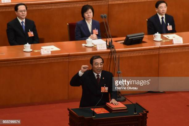 Newly appointed Director of the National Supervisory Commission Yang Xiaodu swears an oath during the sixth plenary session of the National People's...