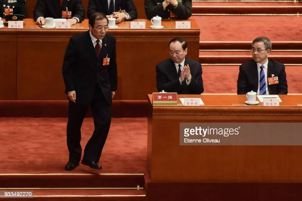 Newly appointed Director of the National Supervisory Commission Yang Xiaodu walks during the sixth plenary session of the National People's Congress...