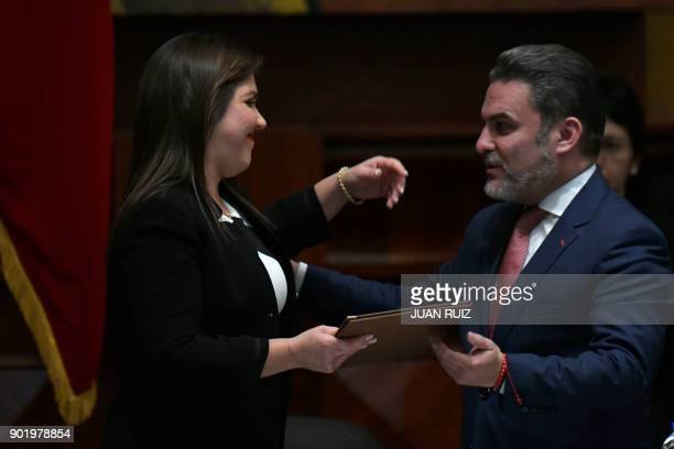 Newly appointed Ecuadorean VicePresident Maria Alejandra Vicuna is greeted by the president of the National Assembly Jose Serrano during the plenary...