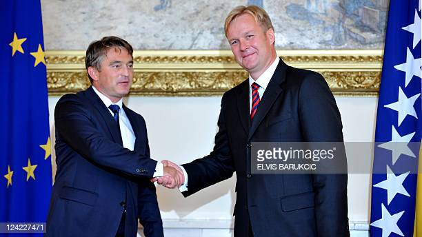 Newly appointed EU Special Representative to Bosnia and Herzegovina Danish diplomat Peter Sorensen shakes hands with Chairman of Bosnia's tripartite...