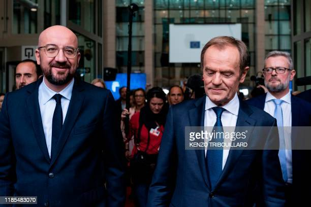 Newly appointed European Council President Charles Michel accompanies outgoing European Council President Donald Tusk leaving the European Council...