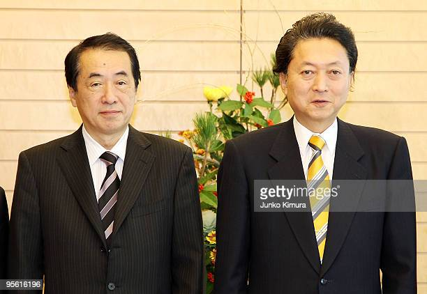 Newly appointed Financial Minister Naoto Kan and Prime Minister Yukio Hatoyama pose for photographs at Hatoyama's official residence on January 7...