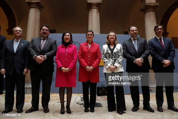 Newly appointed Foreign Minister of Spain Arancha Gonzalez Laya poses for a photo after receiving the portfolio from Newly appointed Defence Minister...