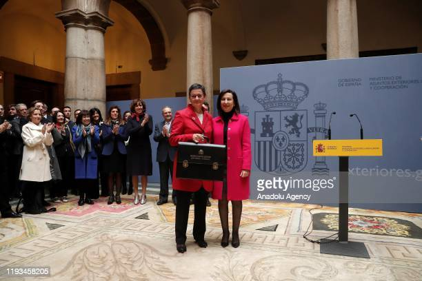 Newly appointed Foreign Minister of Spain Arancha Gonzalez Laya receives the portfolio from Newly appointed Defence Minister of Spain Margarita...
