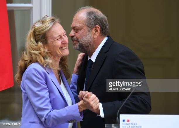 Newly appointed French Justice minister and lawyer Eric DupondMoretti embraces outgoing French Justice Minister Nicole Belloubet after she delivered...