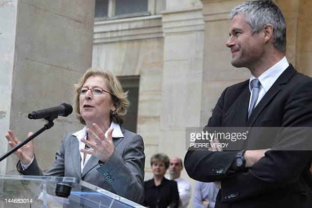 Newly appointed French Minister for Higher Education and Research Genevieve Fioraso gives a speech next to his predecessor Laurent Wauquiez during...