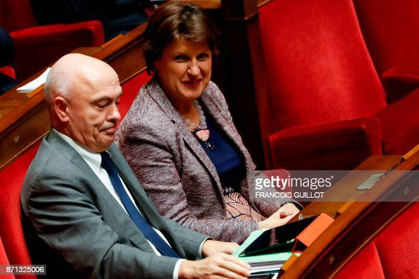 Newly appointed French National Assembly vicepresidents Marc Le Fur and Annie Genevard react after their election at the French National Assembly in...