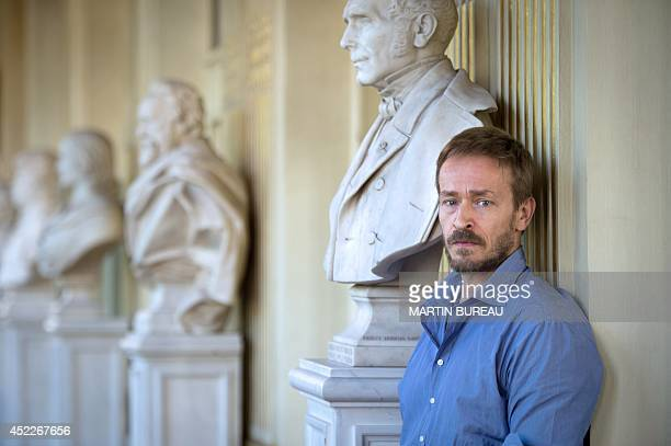 Newly appointed General administrator of the ComedieFrançaise French actor Eric Ruf poses on July 17 2014 at the Comedie Francaise in Paris Ruf who...