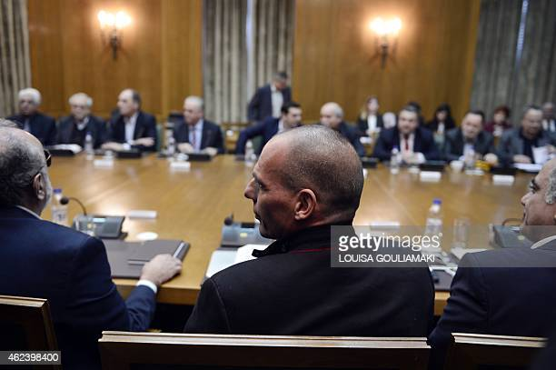 Newly appointed Greek Finance Minister Yanis Varoufakis attends on January 28 2015 the government's first cabinet meeting at the Greek Parliament in...