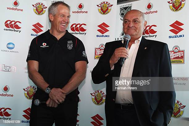Newly appointed head coach Matthew Elliot listens as owner Owen Glenn speaks during a New Zealand Warriors NRL press conference at SkyCity Convention...