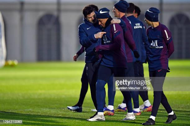 Newly appointed head coach Mauricio Pochettino speaks with Kylian Mbappe during a Paris Saint-Germain training session at Ooredoo Center on January...