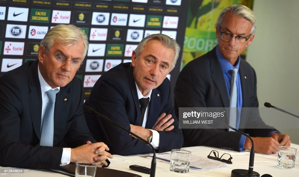 Newly appointed head coach of the Australian national football team, Bert van Marwijk of the Netherlands (C) attends his first press conference with Football Federation Australia (FFA) chairman Steve Lowy (L) and chief executive David Gallop (R) in Sydney on February 1, 2018. Van Marwijk will lead the Socceroos to the 2018 World Cup in Russia after the resignation of former coach Ange Postecoglou who left to take up a position in Japan's domestic J-League. /