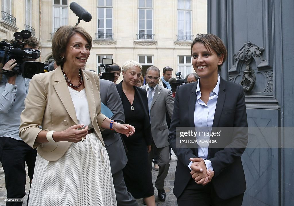 Newly appointed Health and Women's Rights minister Marisol Touraine (L) speaks with outgoing minister Najat Vallaud-Belkacem during a handover ceremony on August 27, 2014 in Paris.