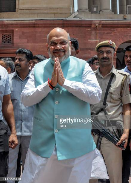 Newly appointed Home Minister Amit Shah gestures as he arrives at the Indian Ministry of Home Affairs in New Delhi on June 1 2019 As the...