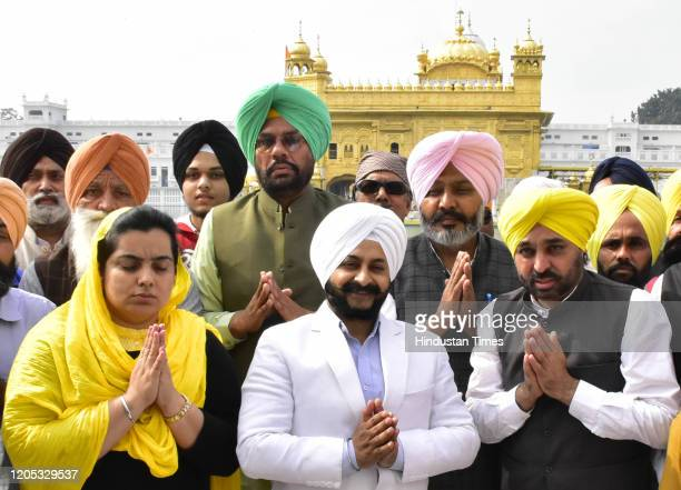 Newly appointed in-charge of Punjab Affairs Aam Aadmi Party Jarnail Singh with Aam Aadmi Party's Punjab unit chief Bhagwant Mann , Leader of...