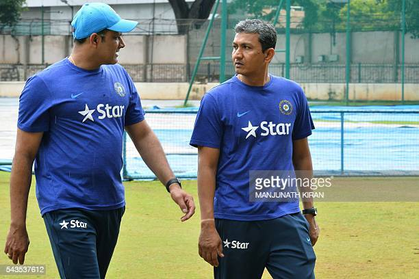 Newly appointed Indian cricket team head coach Anil Kumble and the team's batting coach Sanjay Bangar return after inspecting the ground at the...