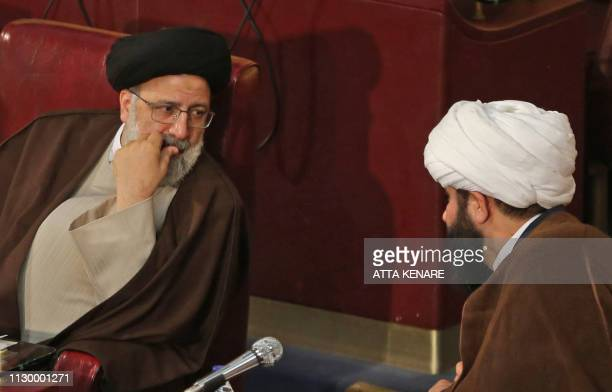 Newly appointed Iranian new judiciary chief ultra-conservative cleric Ebrahim Raisi attends a session of Iran's influential experts assembly in...