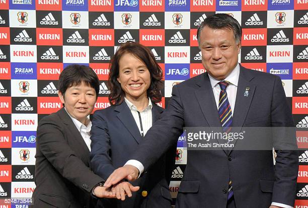 Newly appointed Japan Women's National Team head coach Asako Takakura poses for photographs along with Women's Committee Chairwoman Junko Imai and...