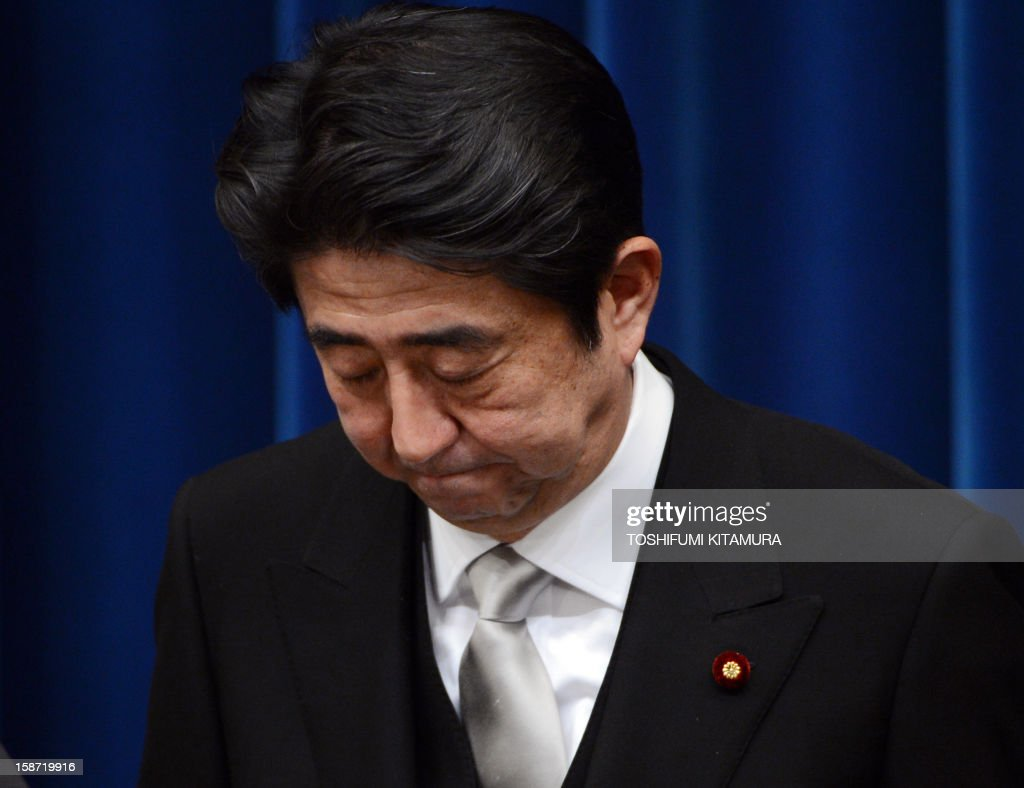 Newly appointed Japanese Prime Minister Shinzo Abe bows to conclude his first press conference at his official residence in Tokyo on December 26, 2012. The powerful lower house named the 58-year-old as the country's new leader following a resounding national election victory for Abe's Liberal Democratic Party earlier this month over the booted Democratic Party of Japan (DPJ).