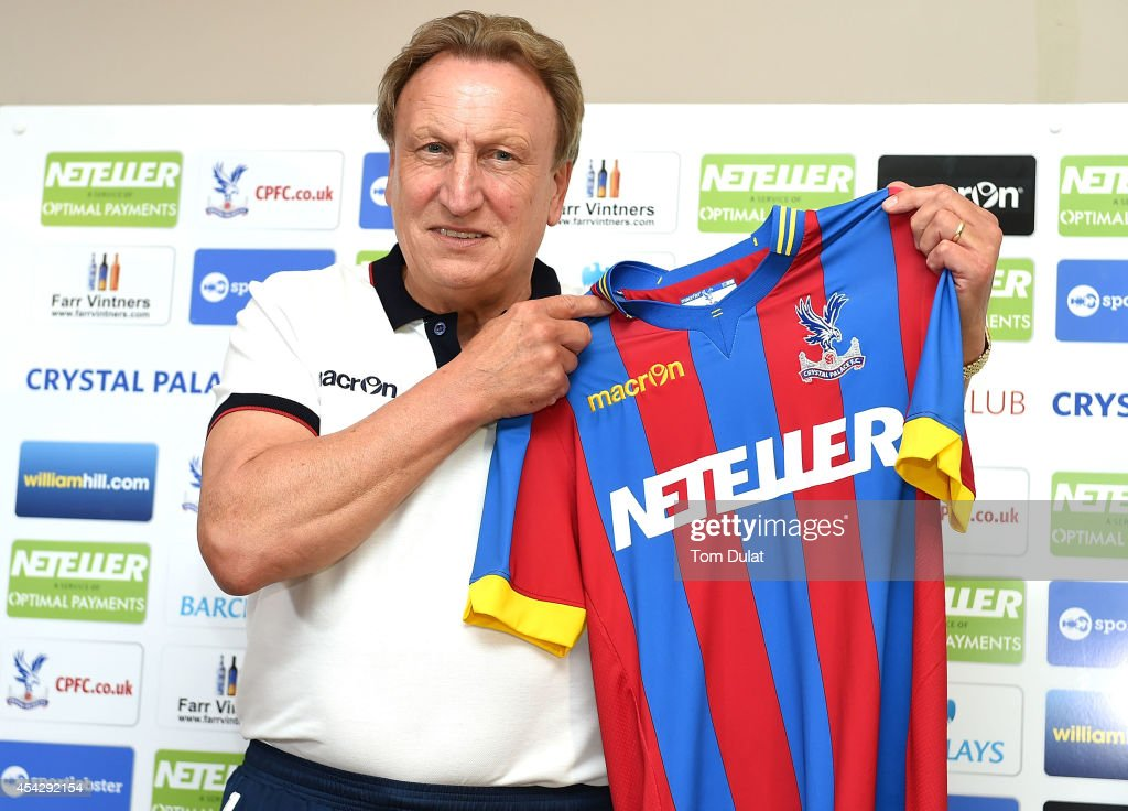 Newly appointed manager of Crystal Palace Neil Warnock poses for photographs during a press conference at Crystal Palace Training Ground on August 28, 2014 in Beckenham, England.