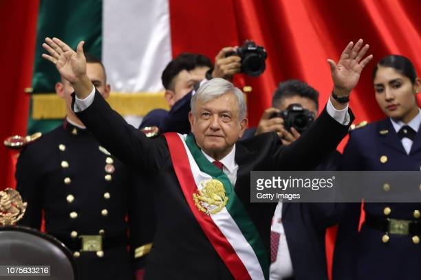 Newly appointed Mexican President Andres Manuel Lopez Obrador waves after the swearingin ceremony during the events of the Presidential Investiture...