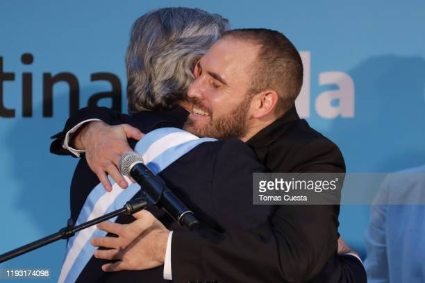 Newly appointed minister of economy Martin Guzman is congratulated by President of Argentina Alberto Fernandez after taking the oath of office during...