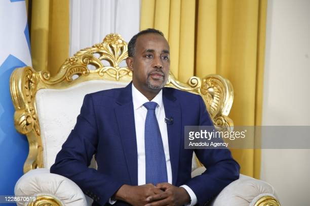 Newly appointed Mohamed Hussein Roble poses for a photo after Somali lawmakers on Wednesday approved Roble as the country's new prime minister in a...