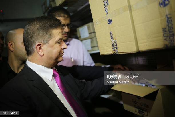 Newly appointed Palestinian Minister of Health Jawad Awwad views a pharmaceutical warehouse in Gaza City Gaza on October 3 2017 Following the...