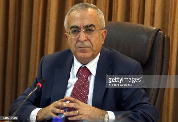 Newly appointed Palestinian Prime Minister of the emergence government Salam Fayyad listens during a cabinet meeting in the West Bank administrative...