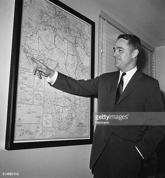 Newly appointed Peace Corps director Sargent Shriver points to a map of Africa Shriver is the brotherinlaw of President Kennedy