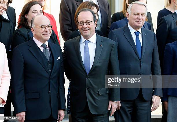 Newly appointed Prime Minister Bernard Cazeneuve French President Francois Hollande and JeanMarc Ayrault French Minister of Foreign Affairs and...