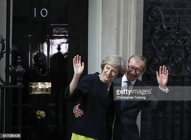 Newly appointed Prime Minister Theresa May with her husband Philip arrives to take up residence in 10 Downing Street on July 13 2016 in London...