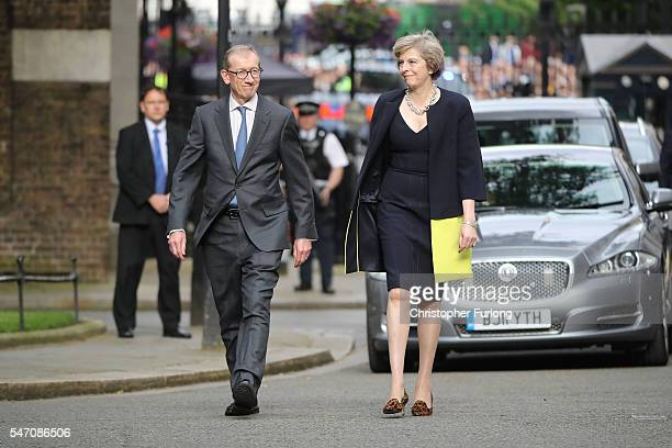 Newly appointed Prime Minister Theresa May with her husband Philip arrive to speak with the press before taking up residence in 10 Downing Street on...