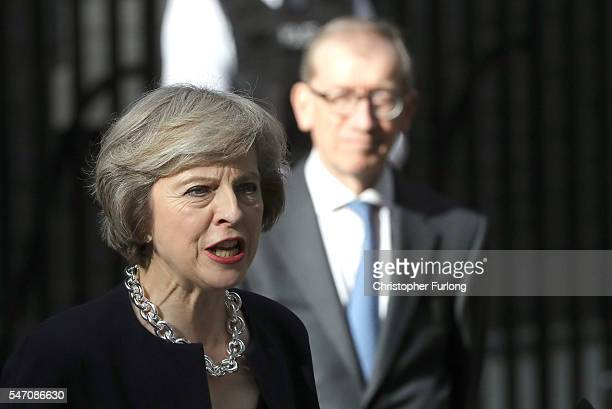 Newly appointed Prime Minister Theresa May with her husband Philip speaks with the press before taking up residence in 10 Downing Street on July 13...