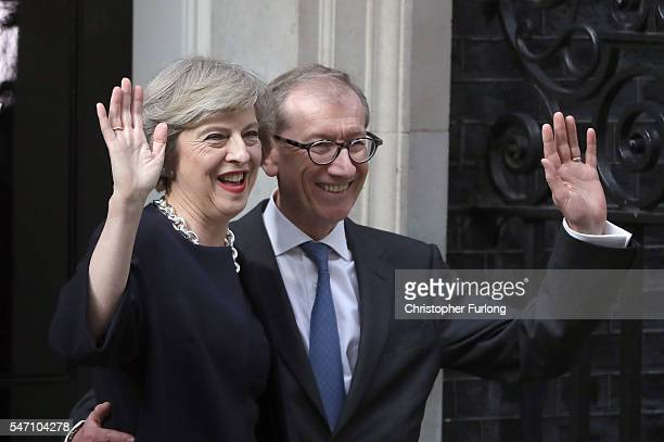 Newly appointed Prime Minister Theresa May with her husband Philip arrive at 10 Downing Street on July 13 2016 in London England Former Home...