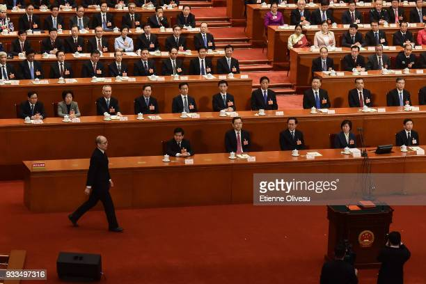 Newly appointed Procurator-General of China's Supreme People's Procuratorate Zhang Jun walks to a podium to swear an oath during the sixth plenary...