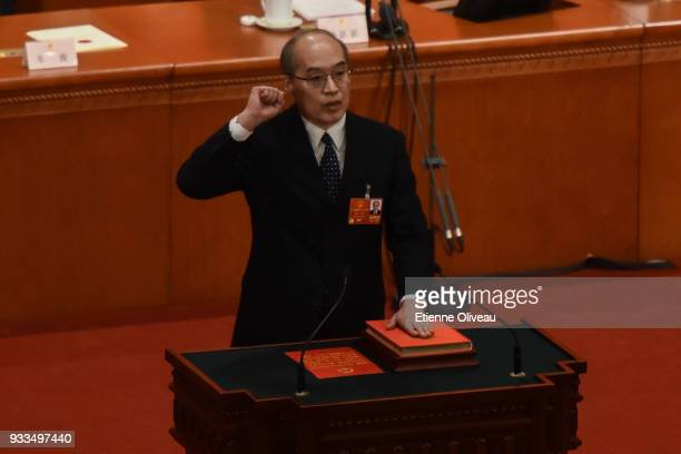 Newly appointed Procurator-General of China's Supreme People's Procuratorate Zhang Jun swears an oath during the sixth plenary session of the...