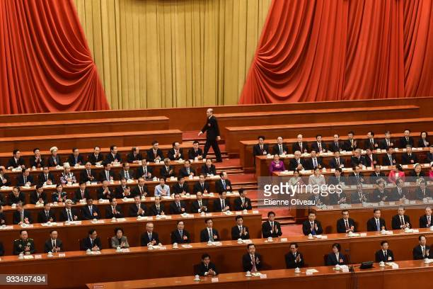 Newly appointed Procurator-General of China's Supreme People's Procuratorate Zhang Jun walks before swearing an oath during the sixth plenary session...