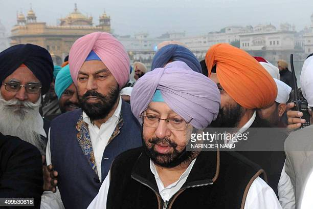 Newly appointed Punjab Congress president Amarinder Singh arrives to pay respects at the Golden Temple in Amritsar on December 2 2015 AFP PHOTO/...