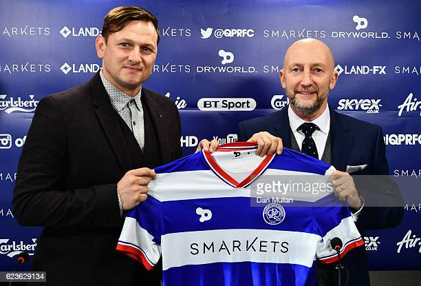 Newly appointed Queens Park Rangers manager Ian Holloway poses with first team coach Marc Bircham during a press conference at Loftus Road on...